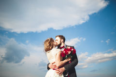 Married wedding couple standing on a wharf over the sea.  Royalty Free Stock Image