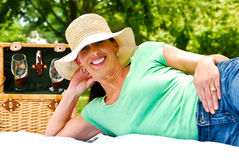 Married woman enjoying a picnic. A married woman enjoys a picnic with her husband royalty free stock photos