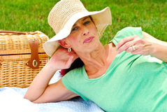 Married woman enjoying a picnic. A married woman enjoys a picnic with her husband royalty free stock image