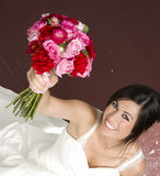 Married Woman Sitting Raised Floral Bouquet. A Bride Seated with Bouquet Stock Photo