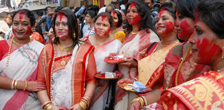 Married Women. Married Bengali Hindu women smear and play with vermilion during Sindur Khela traditional ceremony on the final day of Durga Puja festival on Stock Photos