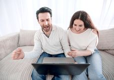 Married young people spend weekends at home together stock images