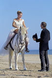 Marrieds and horse. Walking on the beach Stock Photo
