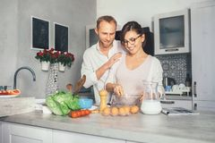 Marrieds prepare breakfast together. At kitchen Royalty Free Stock Photos