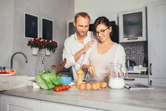 Marrieds prepare breakfast together Stock Image