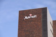 Marriott Hotel logo sign on building. Marriott Hotel is an American multinational hospitality company. Marriott International, Inc. is a leading global lodging Stock Photo