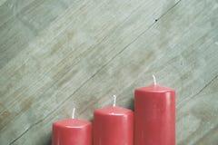 Marrone di legno del fondo della candela di arrivo Fotografia Stock Libera da Diritti