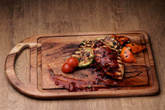 Marrow, bell pepper and fresh cherry toma. Grilled chicken fillet with roasted vegetables: sliced vegetable marrow, bell pepper and fresh cherry tomatoes with Royalty Free Stock Photo