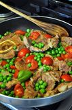 Marrow bone with tomatoes and peas. Italian recipe: marrow bone with tomatoes and peas Stock Photography