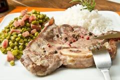 Marrowbone with peas Royalty Free Stock Photo