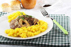 Marrowbone with saffron rice Royalty Free Stock Photography