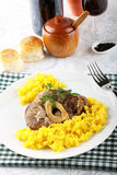 Marrowbone with saffron rice Stock Images