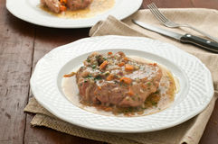 Marrowbone, veal cut used in Italian cooking with yellow risott Stock Photography