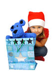 Marry Christmas!. Girl in red Santa Claus with present Royalty Free Stock Image
