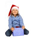 Marry Christmas!. Girl in red Santa Claus with present Royalty Free Stock Photography