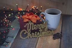 Marry Christmas and a blue cup of coffee and a box on the table Royalty Free Stock Photography