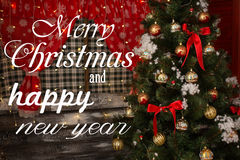 Marry Christmas and happy New Year wishes. There is a beautiful Christmas tree on the background. Vintage holiday card or invitation. Christmas card Stock Images