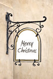 Marry Christmas on a wrought iron old sign Stock Photo