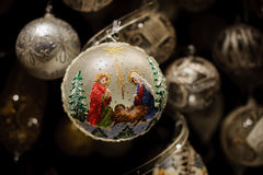 Marry with her son Jesus on christmas ball Royalty Free Stock Image