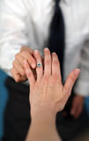 Marry me?. A man proposing and putting a ring on a woman's finger Stock Image