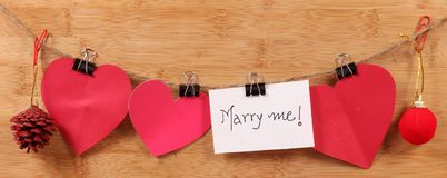 Marry me. Beautiful shot of marry me written on white chit stock image