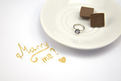 Marry me card on white background with wedding ring Stock Photography