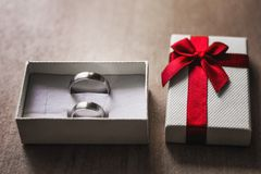 Marry me concept. White box with two engagement rings. stock photo