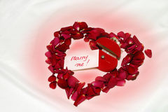 Marry Me! - Engagement. Heart made of real roses petals with engagement ring and little card inside. I will be very happy if you let me know when you use this Stock Photography