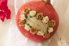 Marry me!. Message attached to a pomegranate: Marry me! Closeup Royalty Free Stock Images