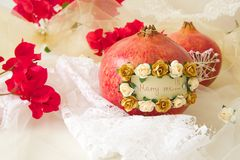 Marry me. Message attached to a pomegranate: Marry me! Flowers in the background Stock Images