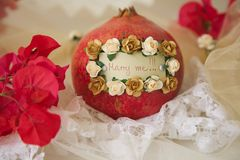 Marry me!. Message attached to a pomegranate: Marry me! Flowers in the background Stock Images