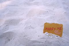 marry me message and diamond ring stock photo
