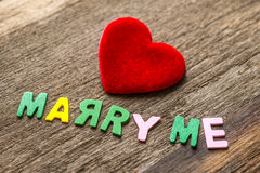 Marry me message written by colour paper Royalty Free Stock Images