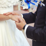 Marry me my darling. Hands of a young wedding couple Stock Photos
