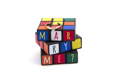 Marry me post card with wedding ring isolated on white background Stock Images