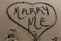 Marry me in sand Stock Photos