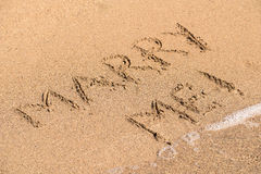 Marry Me Word On Sunny Summer Beach Sand Royalty Free Stock Photography