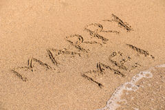 Marry Me Word On Sunny Summer Beach Sand Stock Images