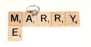 Marry me written with scrabble royalty free stock photography
