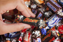 Mars candy in woman's hand Stock Images