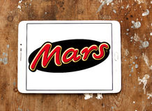Mars chocolate logo. Logo of chocolate brand mars on samsung tablet on wooden background Royalty Free Stock Photography