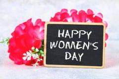 8 mars, jour international du ` s de femmes Tableau avec les fleurs roses Images stock