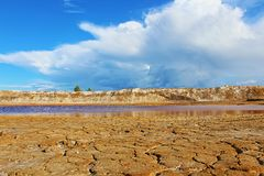 Mars landscape. Water and mountains. Pond and mountains. Mars landscape in the deposit for the extraction of clay. Troitsko-Baynovskoe field, Russia, Sverdlovsk Stock Photos