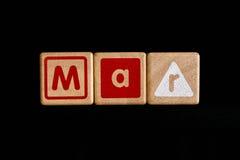 Mars på wood kubik på svart bakgrund royaltyfria bilder