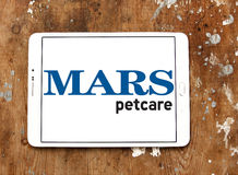 Mars petcare logo. Logo of mars petcare company on samsung tablet on wooden background Stock Image