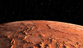 Mars - the red planet. Martian surface and dust in the atmosphere. Royalty Free Stock Image