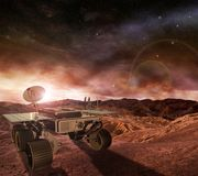 Mars rover exploring the planet. Mars rover exploring the red planet surface under a starry sky and rising sun Royalty Free Stock Photography