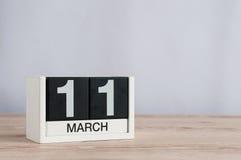 Mars 11th Dag 11 av månaden, träkalender på ljus bakgrund Vårdagen, tömmer utrymme för text Royaltyfri Bild