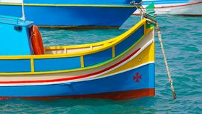 Marsachlokk - MALTA: Colorful Maltese boats in the harbor in Malta in the fishing village of Marsachlokk. Marsachlokk - MALTA: Colorful Maltese boats in the Stock Photography