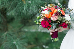 Marsala rustic wedding bouquet with red rose with copy space. On green background Stock Images